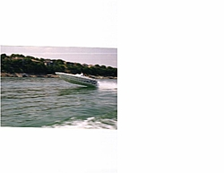How does a 26' scarab compare to a 25' outlaw in rough water?-24-flying.jpg