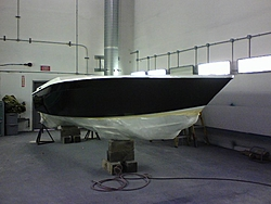 Banana 24 restoration progress-starboard-side-black-paint-before-stripe.jpg