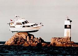 Boat that hit a channel marker-ontherocks.jpg