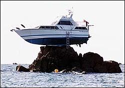 Boat that hit a channel marker-ontherocks2.jpg