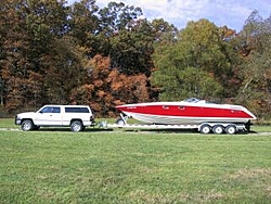 care to guess what the michelob light boat weighs fully rigged on alum trailer-donzi-truck-side-view..jpg