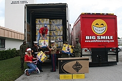 Santa Comes early to needy kids-unload10_sm.jpg