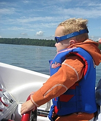 The joy of your first boat ride!!!!!!!!!!  LOL-kyle-driving-rs.jpg