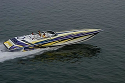 Looking for pics of boats with purple and yellow paint jobs-56327704_1.jpe