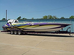 Looking for pics of boats with purple and yellow paint jobs-56327704_2.jpe