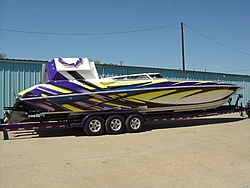 Looking for pics of boats with purple and yellow paint jobs-56327704_3.jpe