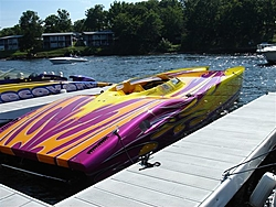 Looking for pics of boats with purple and yellow paint jobs-our-boat.jpg