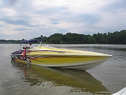 Looking for pics of boats with purple and yellow paint jobs-dave-lori-pulling-away.jpg