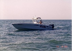 Anybody notice the new trend - CC Outboards?-scarab-onwater1.jpg
