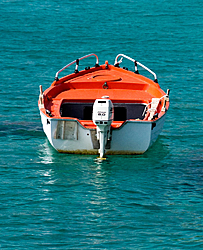 Breaking News on the new OL 29!!!!!!-white_and_orange_boat_on_a_turquoise_sea.jpg