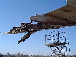 Remember the DHL Plane shot down over Baghdad last week...-lh-wing.jpg