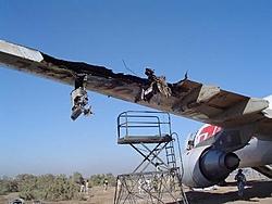 Remember the DHL Plane shot down over Baghdad last week...-lh-wing3.jpg