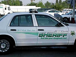 There's a police car behind you on the road, what do you do??-sheriff.jpg