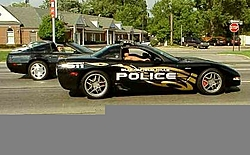 There's a police car behind you on the road, what do you do??-police_corvette_z06.jpg