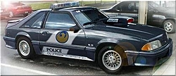 There's a police car behind you on the road, what do you do??-phoenix_az_dare_racecar.jpg