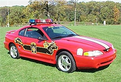 There's a police car behind you on the road, what do you do??-pasp_95_dare_mustang.jpg