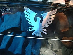 Magnum resto update-emblem.jpg