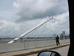Hurricane aftermath from Stuart FL-sailboat-mast-over-bridge.jpg