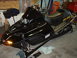 ENOUGH with this heat already!  I just ordered a new snowmobile.  Bring on the SNOW!-sled.jpg
