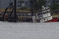 Crew Escapes Injury When Boat Hits Jetty-clammer.jpg