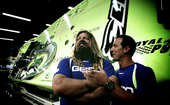 In or out of the limelight, Miss GEICO driver Marc Granet (right) and throttleman Scott Begovich always seem to have a smile on their face. (Photo courtesy Royal Purple.)