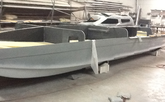 The boat was laid up with carbon fiber, Kevlar and epoxy resins just like the most high-tech hulls in its class.