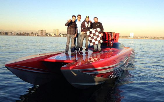 After completing the Marani Bell record run from San Francisco to Long Beach in 8:15:05, the Outlaw Offshore Racing team led by throttleman Bob Russell (right) and driver John Rogers (second from left) stood proudly on the 51-foot Outerlimits catamaran.