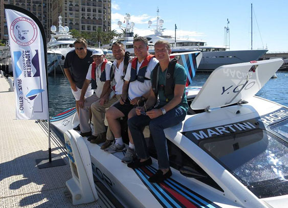The Vector Martini Racing team proudly takes a picture with its raceboat at the Monaco Grand Prix in May.