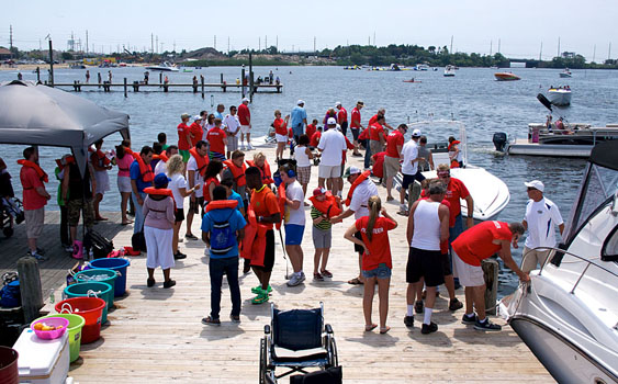 From assisting at the docks to taking kids for rides, it takes dozens of volunteers to make sure the annual Shore Dreams for Kids runs smoothly. Photo by Tim Sharkey