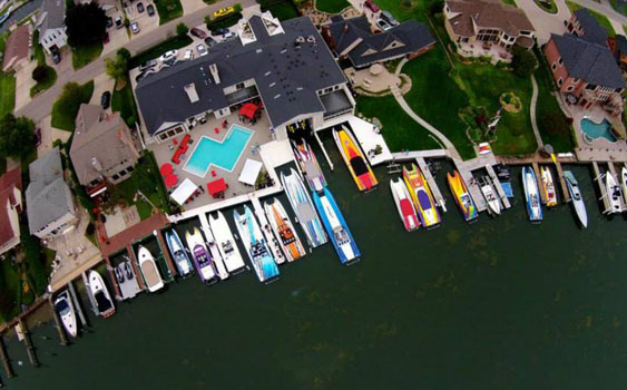 Szolack's waterfront home in Michigan is impressive—even more so with more than a dozen Skater catamarans behind it. Photo courtesy Chip Miller