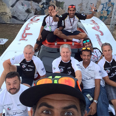 """Welcome to offshore racing's version of the """"United Nations""""—the Abu Dhabi team strikes a selfie pose with (from left) Ballough, Scism and Tomlinson."""