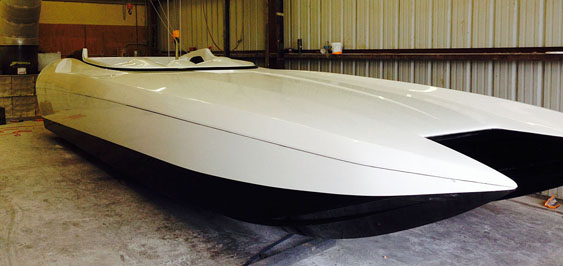 With a white-and-black gelcoat base, DCB's M35 is nearly ready for its custom paint job.