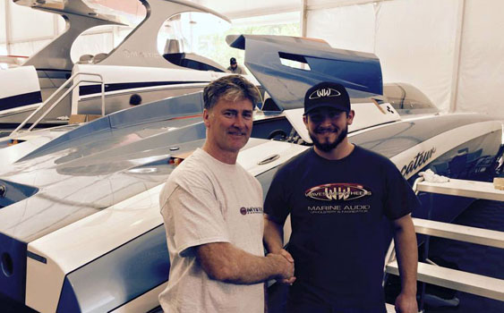 Josh Roark of Waves and Wheels (right) assisted Mystic founder John Cosker with some last-minute boat show preparation.
