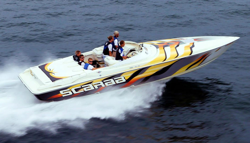 Chris Dekker, who drove his 33-foot Scarab in the 2014 Boyne Thunder Poker Run, is one of the founding members of the new West Michigan Offshore club.