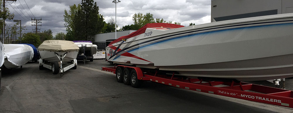 With rain in the Southern California forecast earlier this week all of the boats outside the shop needed to be covered.