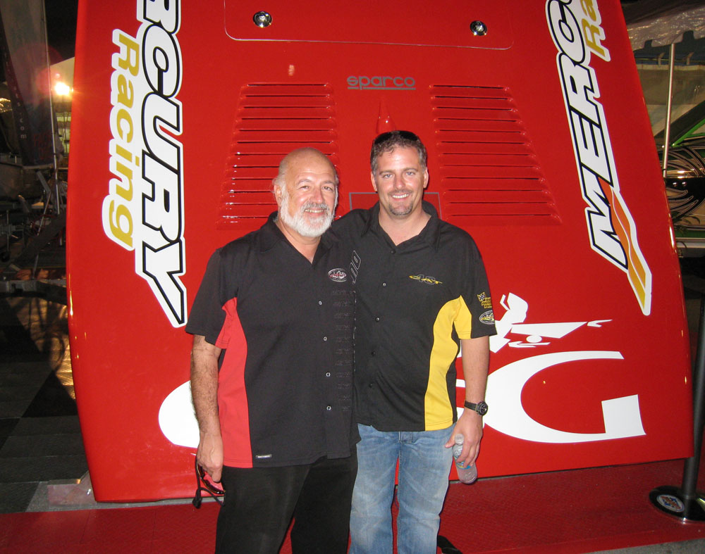 Paul and Mike Fiore share a classic father-and-son moment at the Miami International Boat Show in 2008. Photo courtesy Outerlimits