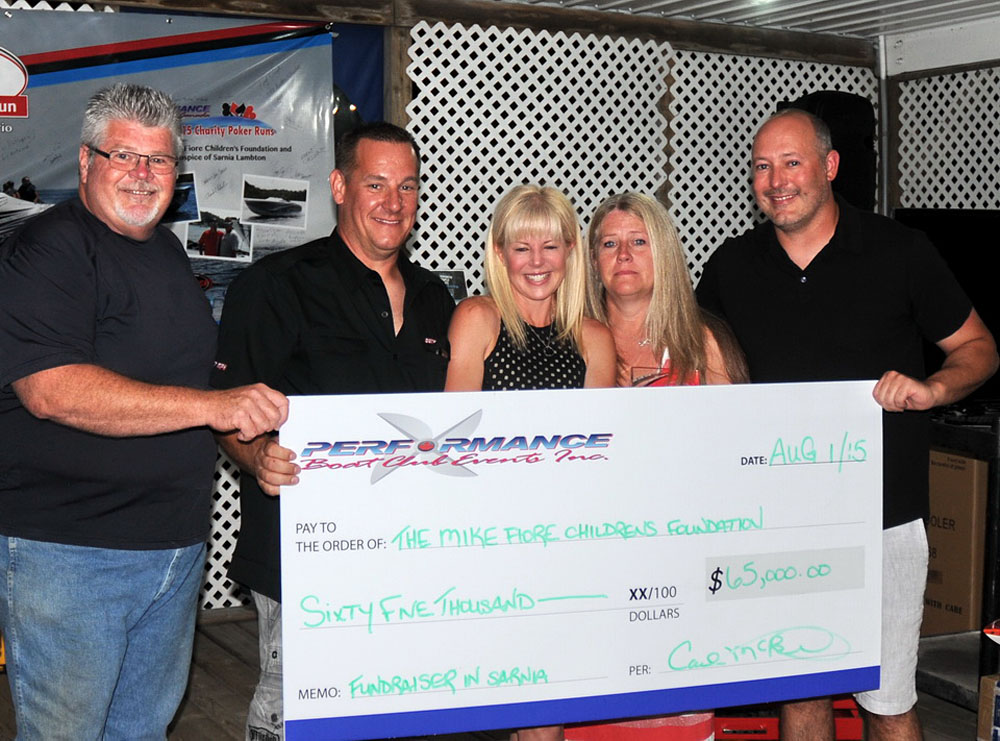 Posing with the generous donation from Performance Boat Club Events is, from left, PBCE President Carl McBride, Title Sponsor Dave Scotto from Concord Hardware/Team GottaGo, Shonda Whipple-Fiore, Dawn Scotto and Dustin Whipple. Photo courtesy Carl McBride/DPG Media