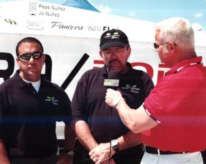 Jo and Pepe Nuñez do an interview during an offshore race in Miami in 2002. Photo courtesy Pantera Boats