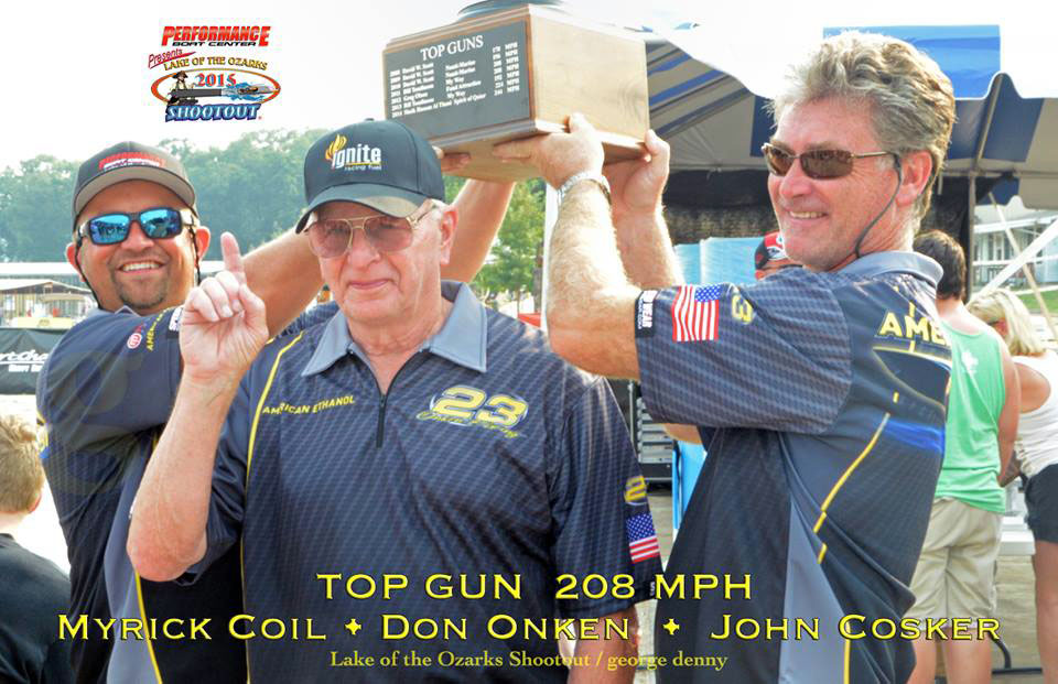 After running 208 mph in the American Ethanol Mystic, Myrick Coil (left) and John Cosker (right) proudly held the Lake of the Ozarks Shootout Top Gun trophy over owner Don Onken's head.