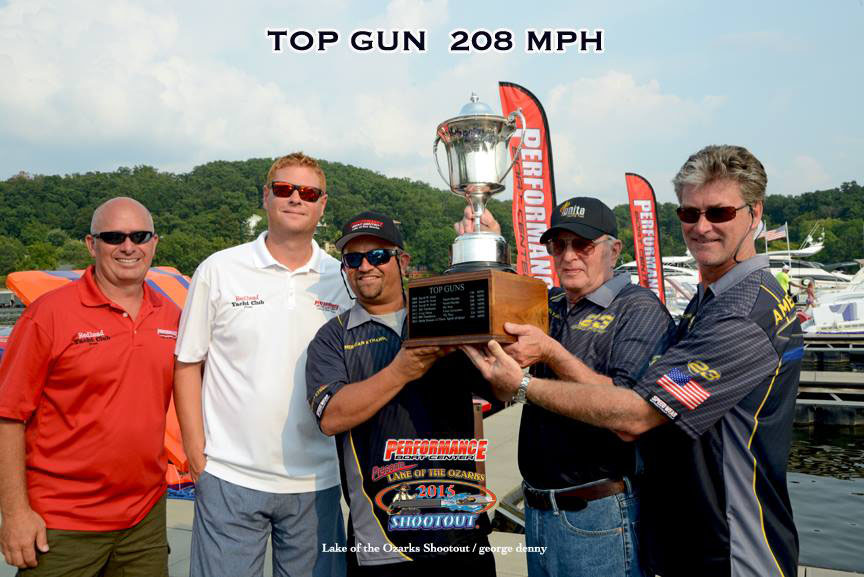 From left: Performance Boat Center's Mark Waddington and Brett Manire joined Coil, Onken and Cosker for a picture with the Top Gun trophy.