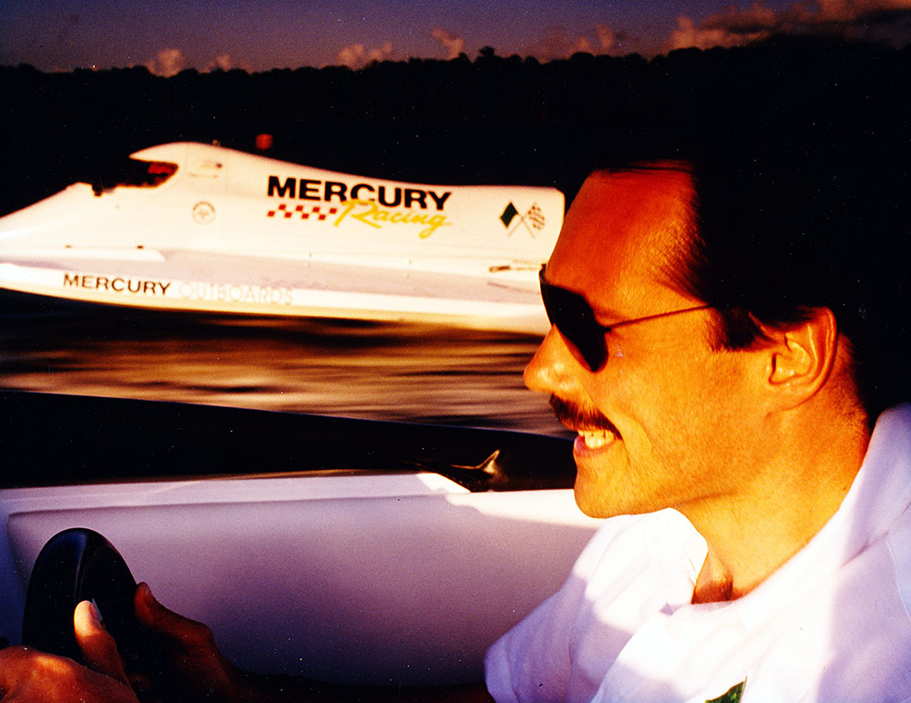 With Mercury's Seebold tunnel boat as the subject, Rick Mackie runs a 24-foot Skater with a Pro Max 225X Offshore on Lake X during a photo shoot for the company's 1996 outboard catalog.