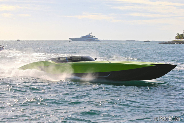 OSOTRULIO304-02 Mercury Racing's 1550/1350 engines became the powerplants-of-choices for high-end performance boats such as this Gino Gargiulo's 52-foot Lamborghini-themed MTI catamaran. Photo by Pete Boden/Shoot 2 Thrill Pix. (https://www.facebook.com/Shoot-2-Thrill-Pix-130528070292399/?fref=ts)