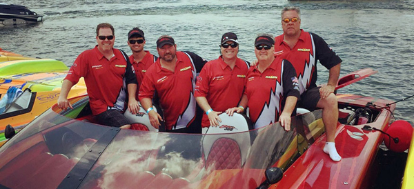 Powerboat owners around the country mourned the death of dedicated concierge Tom Healey (far right) Photo courtesy Michael Ciasulli.