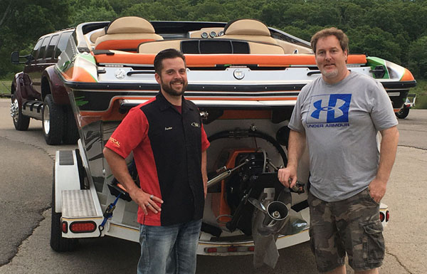 Justin Wagner and Andy Imhof stand in front of the 30-foot Profile V-bottom that their respective teams at Waves and Wheels and Maryland Offshore Marine Center completed last summer.